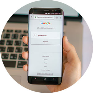 Person holding phone with Google add account open